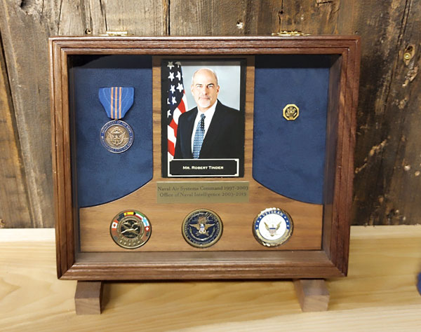 Retirement shadowbox for a navy retiree